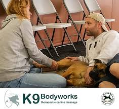 K9 Partners For Patriots Service Dog with Vréli of K9 Body Works Clinical Canine Massage